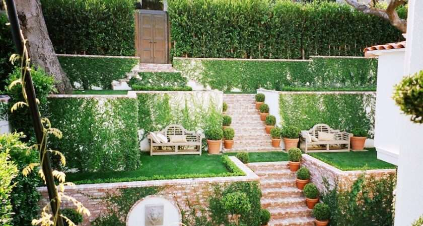 Awesome Tiered Garden Brick Stairs Grass Patches Vine Covered Walls