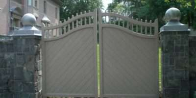 Beautiful Fence Design Uses Stone Columns Wooden Panels