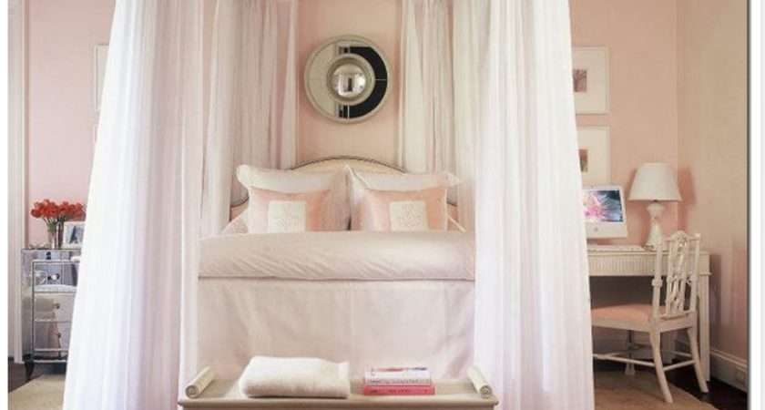 Beautifully Arranged Pillows Canopy Bed Pink White