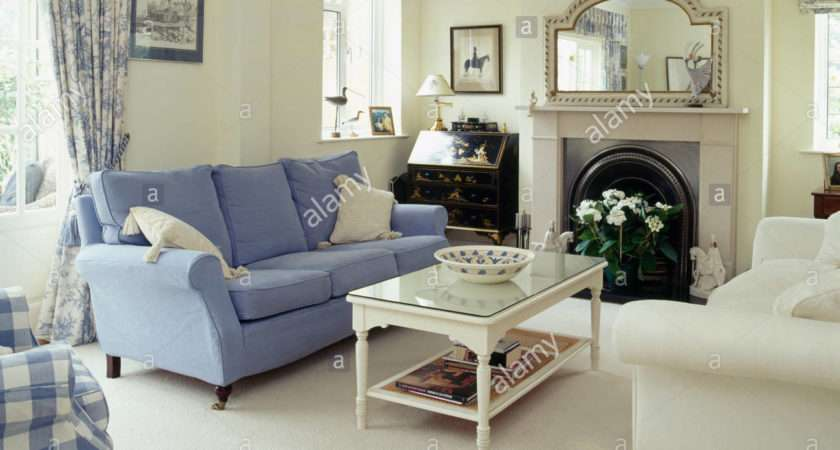 Blue Cream Sofas Either Side Fireplace
