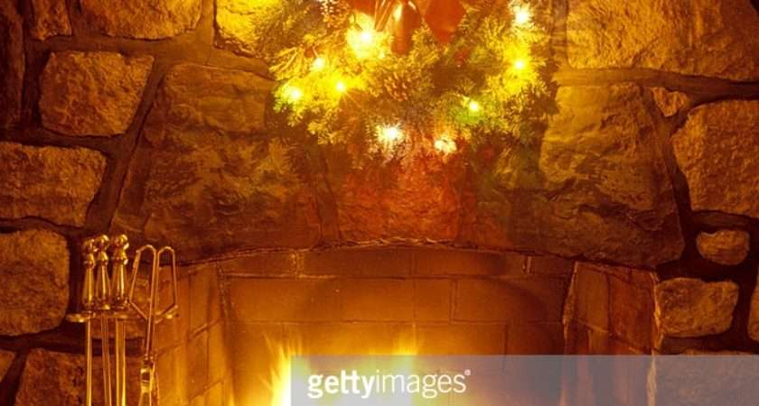 Christmas Wreath Over Fireplace Getty
