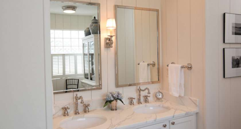 Cottage Bathroom Features Vertical Wall Panels Framing Polished Nickel