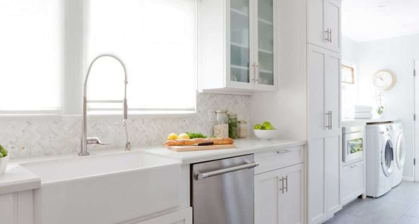 Long Kitchen Features White Shaker Cabinets Paired Off