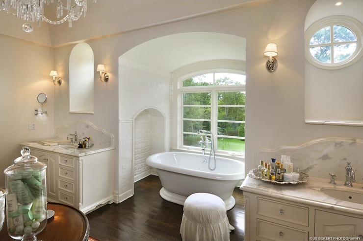 Master Bathroom Bathtub Alcove Flanked White Vanities Paired