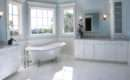 Soft Sky Blue Walls Float Above White Cabinetry Marble