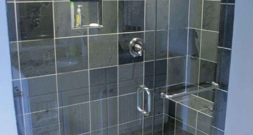 White Acrylic Surround Jacuzzy Beside Glass Wall Shower