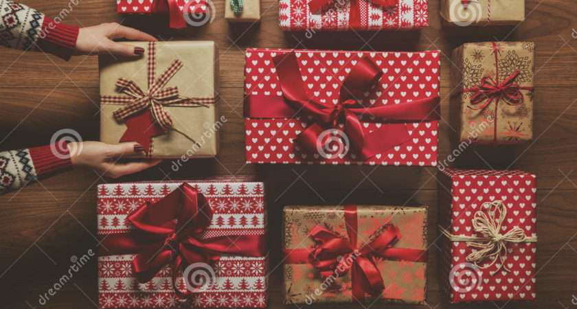 Woman Organising Beautifully Wrapped Vintage Christmas